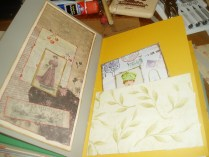 card that opens and a pocket with mixed media art card.