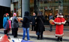 Native women drumming on the steps of TransCanada's head office