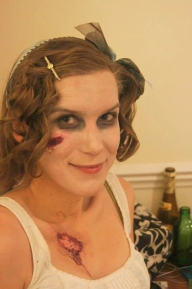 a picture of a young woman with zombie make-up and Georgian era costume, at a Pride, Prejudice and Zombies themed halloween party
