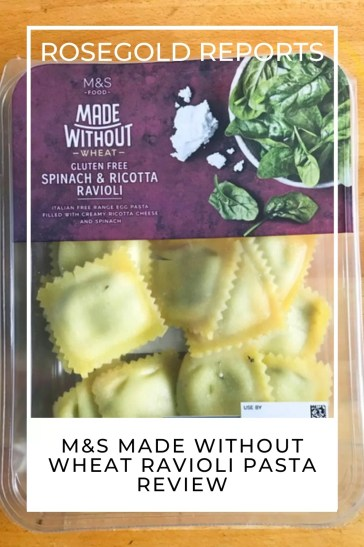 A packet of M&S made without wheat ravioli on a wooden counter top with the words rosgold reports at the top and review at the bottom.