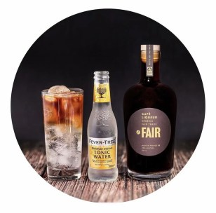 a bottle of fair cafe liqueur, a bottle of fevertree tonic and a glass of cafe tonic cocktail