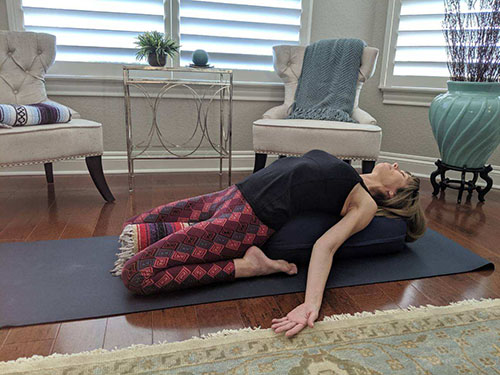 Restorative yoga hero pose
