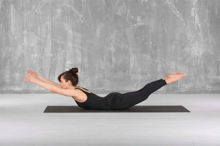 Locust Pose strengthens your back for more confident posture.