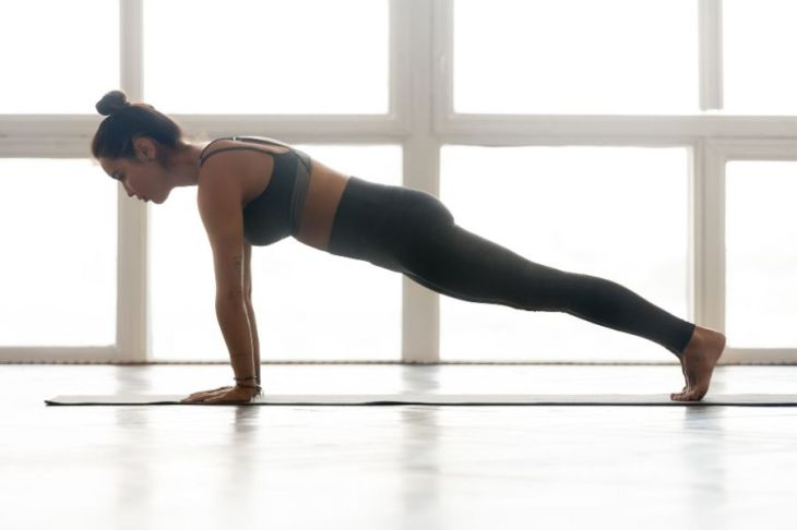 Plank Pose builds core strength for self-confident posture