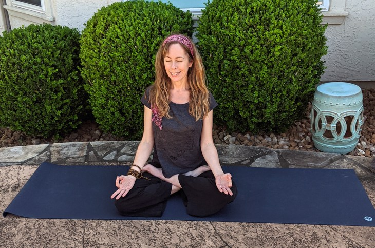 Unlock your crown chakra energy with lotus pose