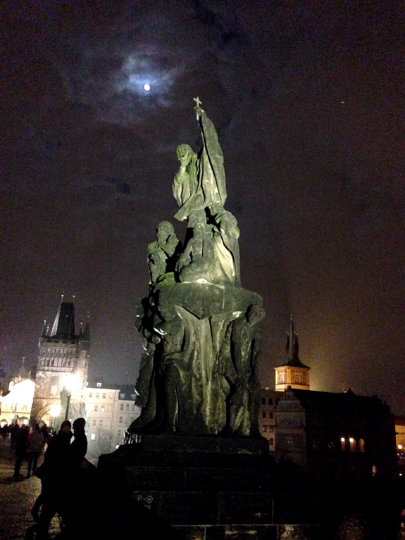 Crossing the Charles Bridge at night