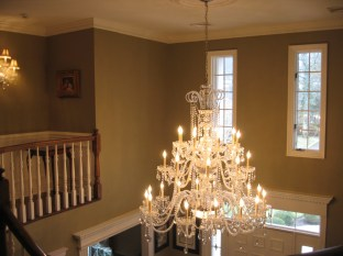 Two story foyer area with Schonbek chandelier