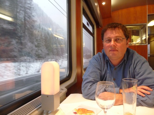 Monsieur Le Chic relaxing in the dining car and watching the snow storm outside (it got worse after this photo was taken)!