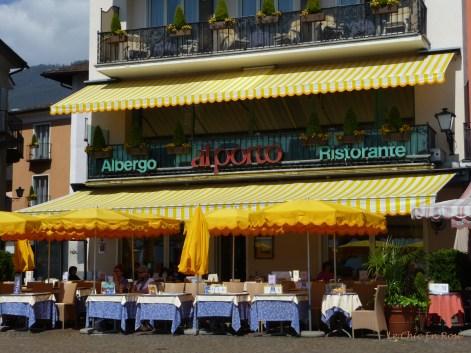 Facade of the Albergo Al Porto and street terrace