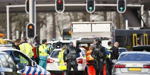 """Emergency services stand at the 24 Oktoberplace in Utrecht, on March 18, 2019 where a shooting took place. Several people were wounded in a shooting on a tram in the Dutch city of Utrecht on March 18, police said, with local media reporting counter-terrorism police at the scene. """"Shooting incident... Several injured people reported. Assistance started,"""" the Utrecht police Twitter account said. """"It is a shooting incident in a tram. Several trauma helicopters have been deployed to provide help."""" - Netherlands OUT / AFP / ANP / Robin van Lonkhuijsen"""