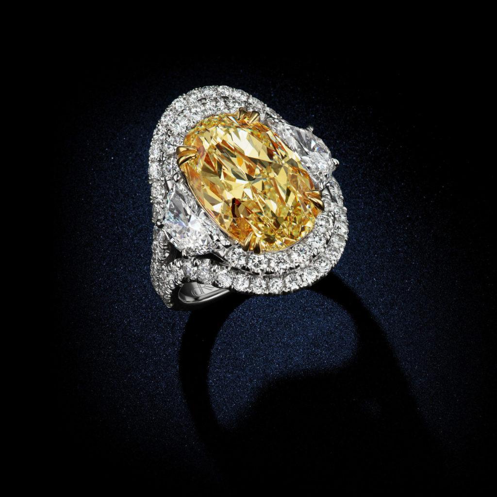 888 Carat Fancy Intense Yellow VVS1 Oval Shape Diamond
