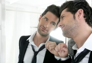 Handsome narcissistic young man looking in a mirror, human resources, hr