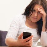 Upset Woman Reading A Text Message
