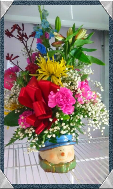 Christmas centerpiece by rose petals florist —