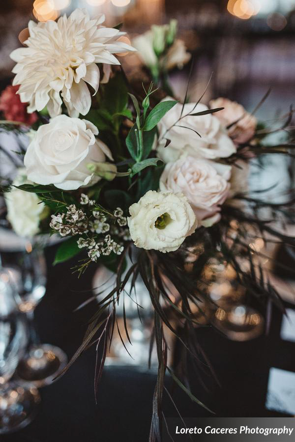 Flowers in a silver urn, roses and dahlias.