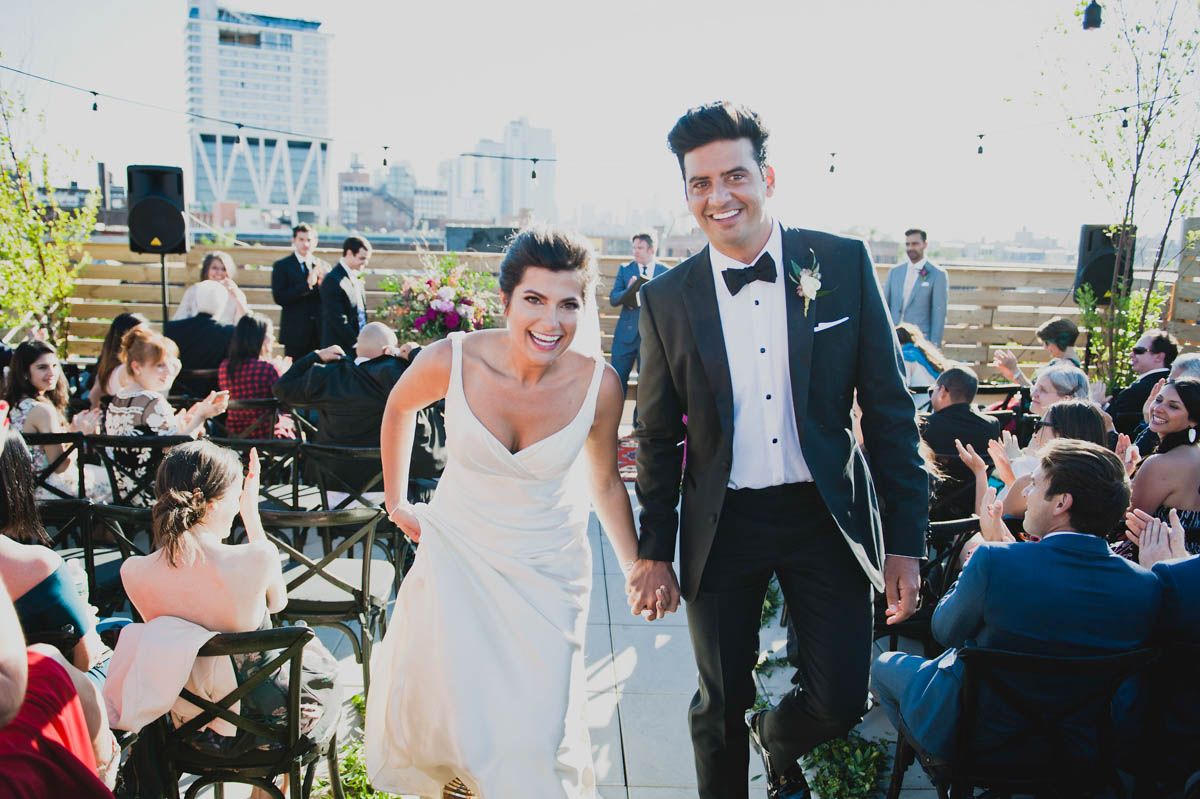 Beautiful Bride and Groom at a roof top wedding at Dobbin Street in Brooklyn