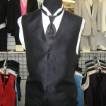 Matching vest and long neck tie.
