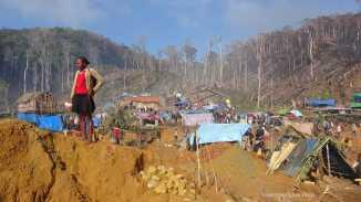 "Miner and Tented Community at ""rush site"" near Ambatondrazaka, Madagascar. October 2016"