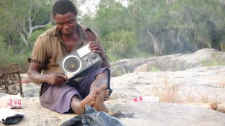 Fisherman and his radio, Niassa. Photo: Rosey Perkins
