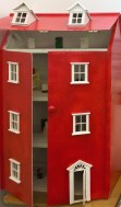 Close up of my dollshouse with the new plaster figures inside