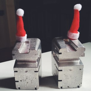 Processed with VSCO with f2 preset My two metal figures with the mini Santa hats on them I bought.