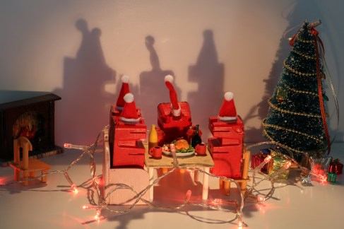Red Figures set up having there christmas Dinner