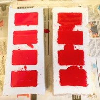 Two silicone moulds with the resin mixture in them drying