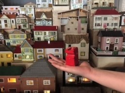 Holding my Red Figure against the lit up Dolls Houses