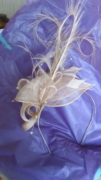 Peach-coloured sinamay, feather and pearl fascinator by Max and Ellie