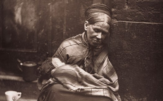 An impoverished woman in St Giles, looking after the baby of a friend who has been lucky enough to find a day's work. Picture: Museum of London