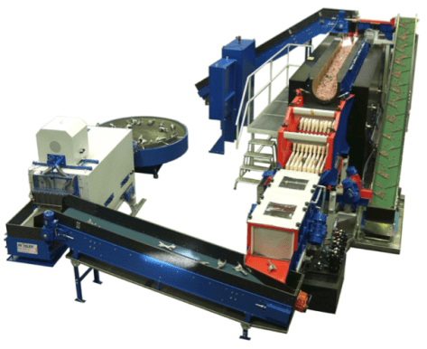 This Rosler DA system is equipped with part and media conveyors on an inline vibratory machine.