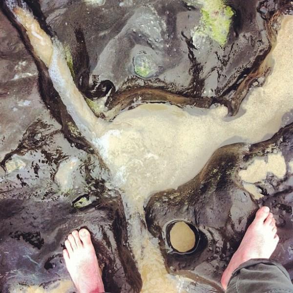 Feet, rock, water...