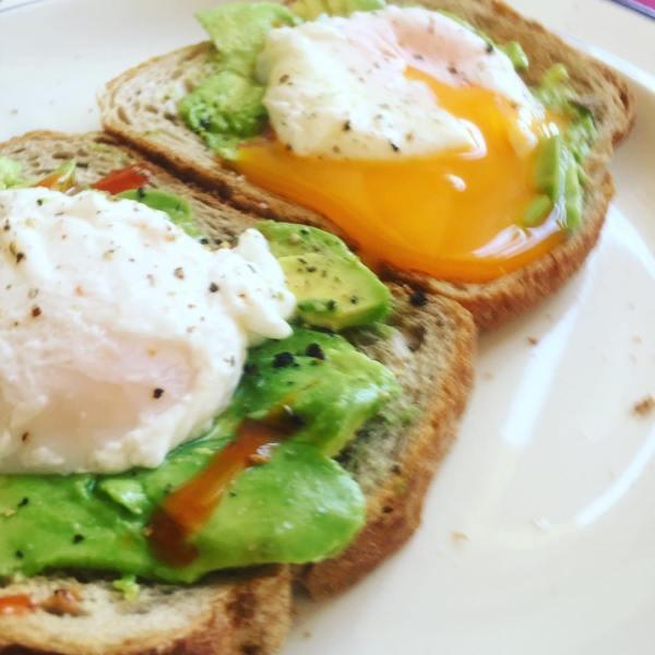 Smashed Avo on Rye with poached eggs & Sriracha