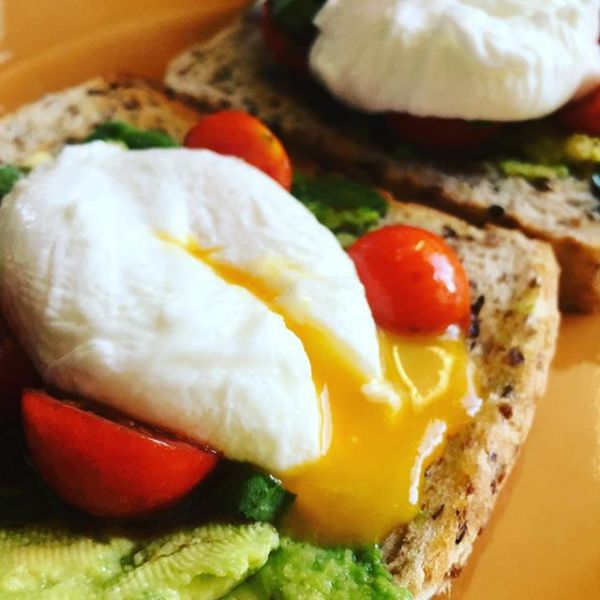 Smashed Avo & poached egg with homegrown basil & tomatoes