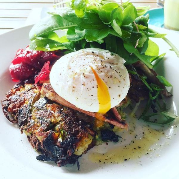 Bubble & squeak rosti with corned beef brisket, poached egg, beetroot relish & greens