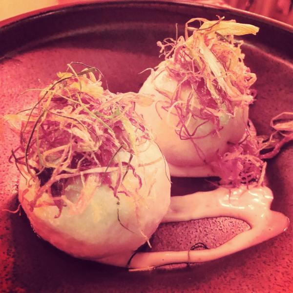housemade sriracha steamed pork buns - Thai chili jam, sesame dressing, fried shallot, kafir lime