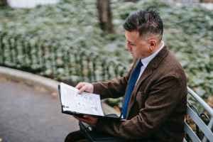 photo of man looking through documents