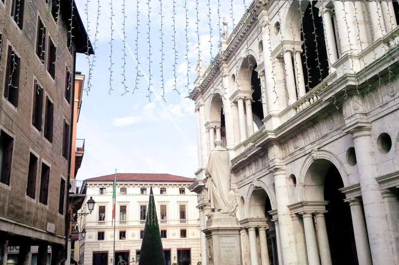 A curtain of Christmas lights hanging over Palladio's monument and the Basilica Palladiana - Vicenza, Italy - rossiwrites.com