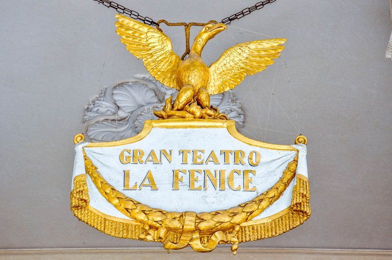 The golden phoenix crowns the entrance - La Fenice Opera House in Venice, Italy - www.rossiwrites.com