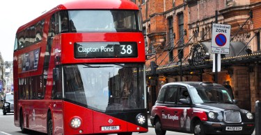 A double-decker bus and a black cab, London, England