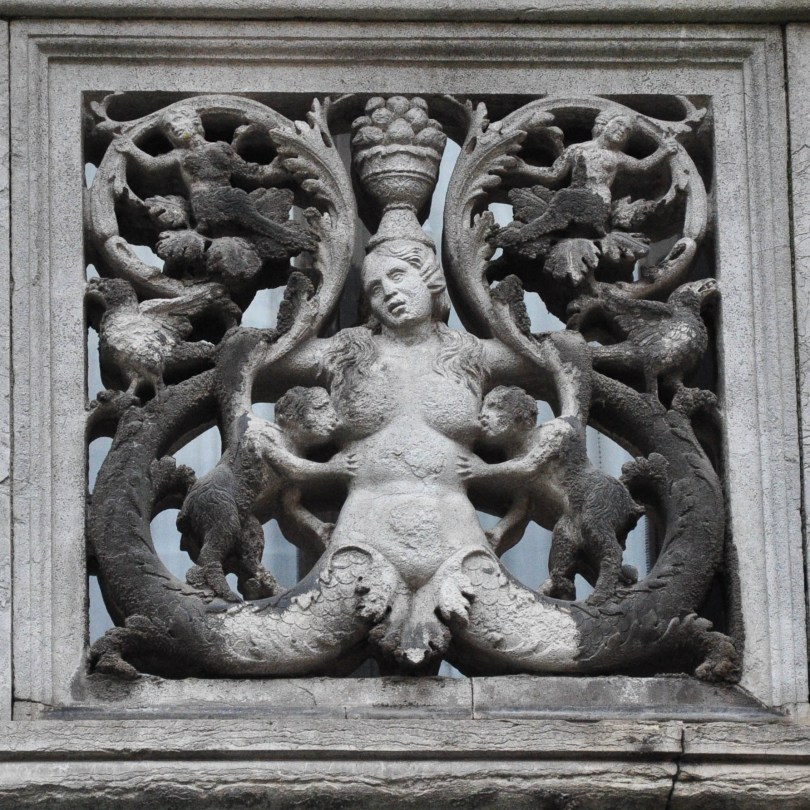 A close-up of a balcony with a brestfeeding bas-relief, Venice, Italy