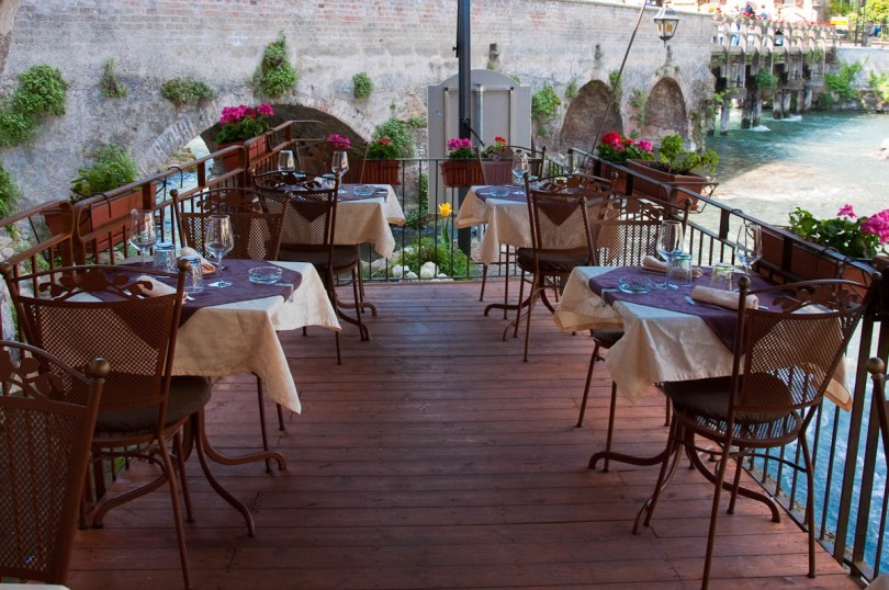 The terrace over the river Mincio of Cafe Visconti, Borghetto sul Mincio, Italy