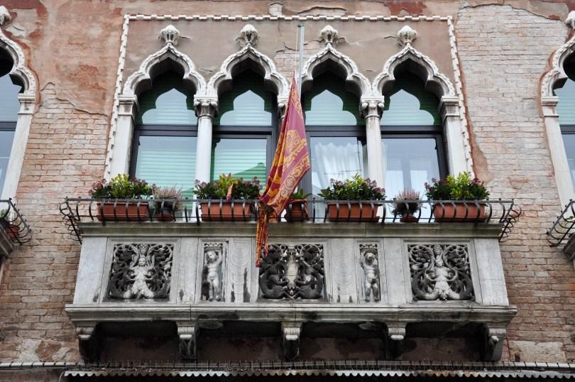 Balcony with a brestfeeding bas-relief, Venice, Italy