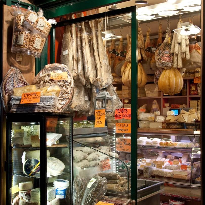A small deli shop on the ground floor of Palazzo della Ragione, Piazza delle Erbe, Padua, Italy - www.rossiwrites.com