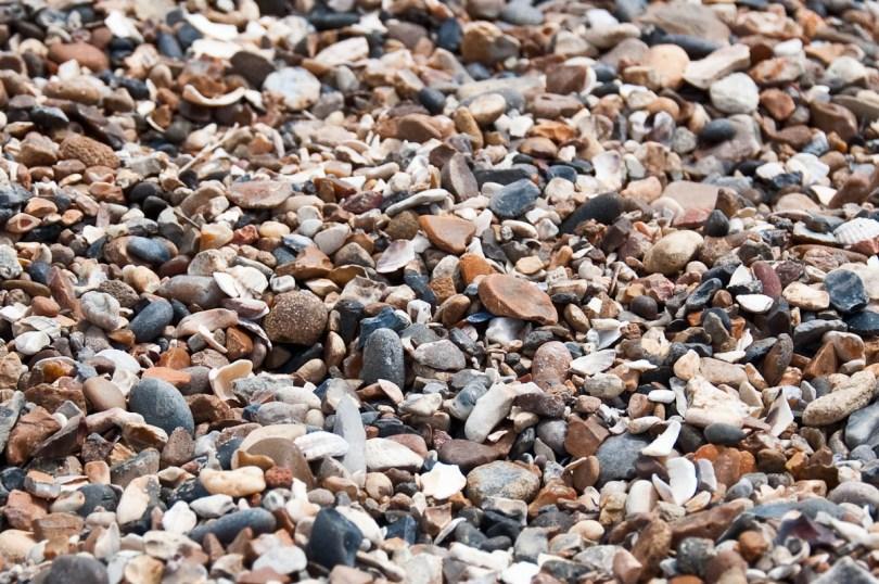 A pebbly beach, Mersea Island, Essex, England - www.rossiwrites.com