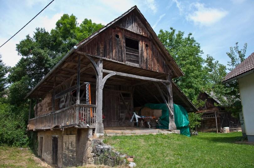 A traditional Slovenian wooden barn - kozolec, Bela Krajina, Slovenia - www.rossiwrites.com