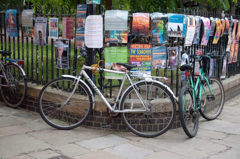 Bikes chained to metal railings, Cambridge, England - www.rossiwrites.com