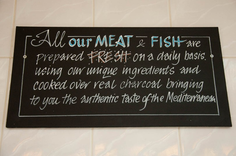Sign on the wall, The Master Fryer Fish and Chips Shop, St. Albans, England - www.rossiwrites.com