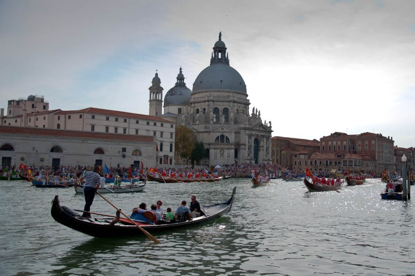 A gondola and boats in front of Santa Maria della Salute, Historical Regatta, Venice, Italy - www.rossiwrites.com