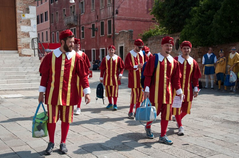All in costume and clutching the layout of the boats the participants in the regatta arrive at the meeting point, Arsenale, Historical Regatta, Venice, Italy - www.rossiwrites.com